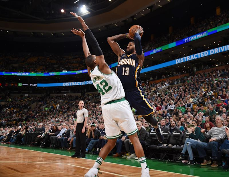 Paul George might prefer getting to defend with Al Horford to getting defended by him. (Getty Images)