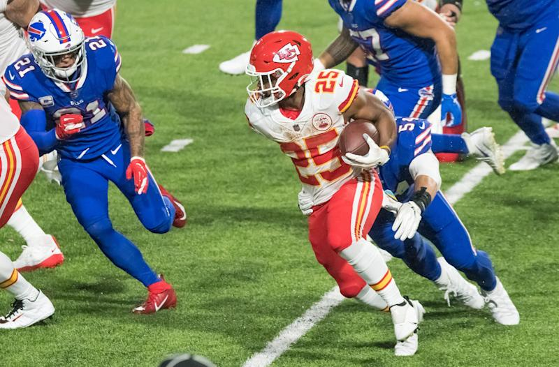 Oct 19, 2020; Orchard Park, New York, USA; Kansas City Chiefs running back Clyde Edwards-Helaire (25) runs against Buffalo Bills free safety Jordan Poyer (21) and outside linebacker A.J. Klein (54) in the third quarter at Bills Stadium. Mandatory Credit: Mark Konezny-USA TODAY Sports