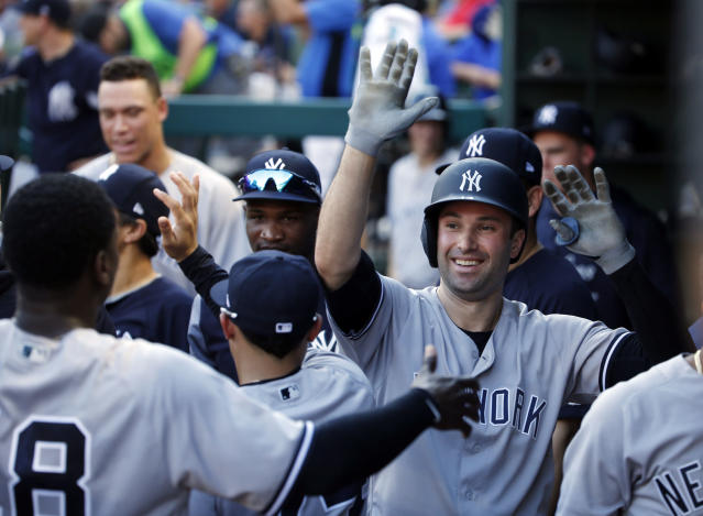 New York Yankees Neil Walker (14) celebrates his solo home run against the Texas Rangers during the third inning of a baseball game Wednesday, May 23, 2018, in Arlington, Texas. (AP Photo/Michael Ainsworth)