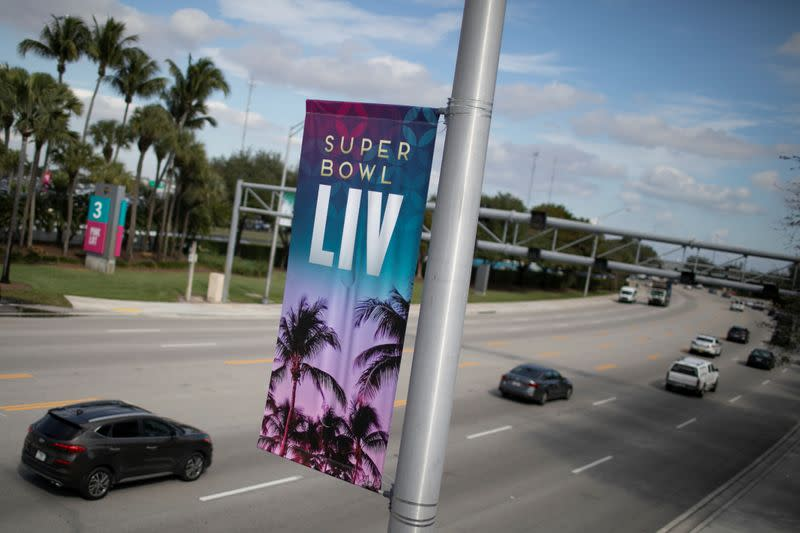 A banner advertising Super Bowl LIV between the San Francisco 49ers and the Kansas City Chiefs is displayed in Miami Gardens