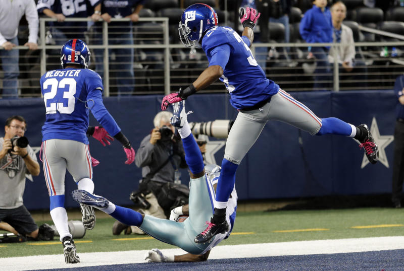 Dallas Cowboys wide receiver Dez Bryant (88) makes a last-minute reception between New York Giants cornerbacks Corey Webster (23) and Michael Coe (37) for a touchdown that was nullified after review during an NFL football game, Sunday, Oct. 28, 2012, in Arlington, Texas. Bryant's hand landed on the line. The Giants won 29-24. (AP Photo/Sharon Ellman)