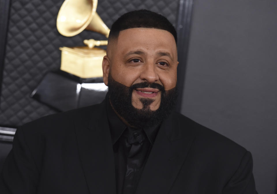 "FILE - This Jan. 26, 2020 file photo shows DJ Khaled at the 62nd annual Grammy Awards in Los Angeles. Stay-at-home orders, traveling fears and the cancellation of sporting events, concerts and theme parks have forced the Make-a-Wish foundation to come to a stand-still, leaving young people's requests in holding patterns. The charity has introduced ""Messages of Hope,"" encouraging the public and celebrities to record inspiring messages and upload them to social media, and so far, stars like DJ Khaled have already participated. (Photo by Jordan Strauss/Invision/AP, File)"