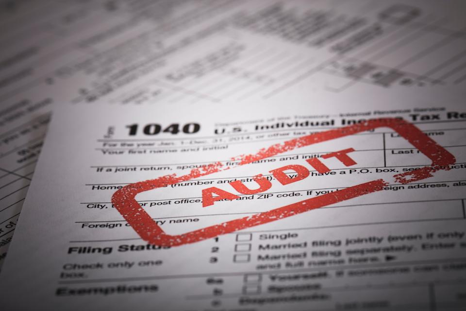 A stock photo of a Red Audit stamp on a 1040 US individual income tax return. Photographed at 50mp with the Canon EOS 5DSR and the 100mm 2.8 L lens.