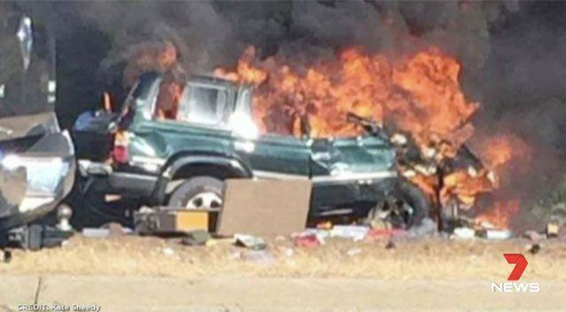 Southern's Landcruiser rolled and caught fire. Picture: 7 News