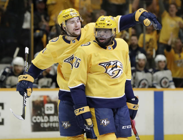 Nashville Predators defenseman P.K. Subban (76) is congratulated by left wing Filip Forsberg (9), of Sweden, after scoring a goal against the Winnipeg Jets during the second period in Game 2 of an NHL hockey second-round playoff series Sunday, April 29, 2018, in Nashville, Tenn. (AP Photo/Mark Humphrey)