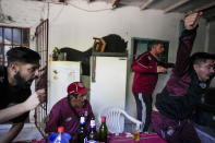 Lanus soccer fans celebrate their team's second goal against Gimnasia y Esgrima La Plata, as they watch the game on television while COVID-19 pandemic restrictions keep fans from stadiums in Lanus, Argentina, Wednesday, Aug. 25, 2021. Few places in the world have soccer fans more passionate than those in Argentina, and few have been so long denied a live view of their teams due to the pandemic. (AP Photo/Natacha Pisarenko)