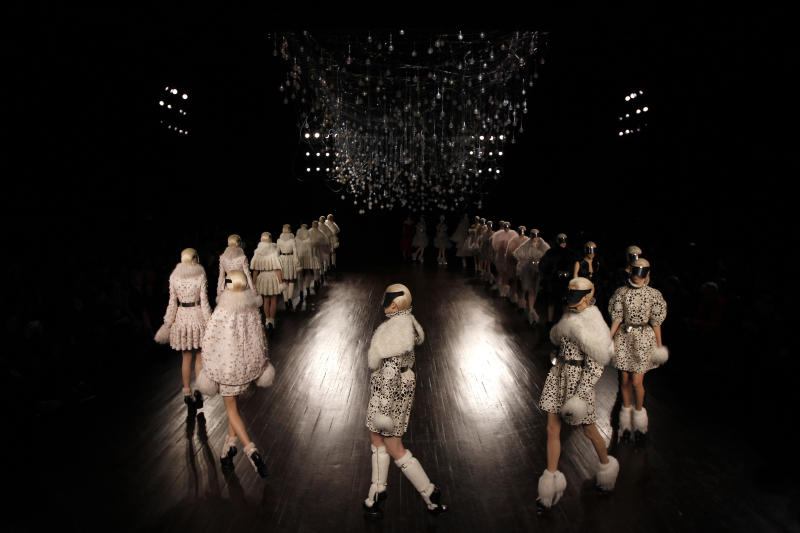 Models wear creations by British designer Sarah Burton for Alexander McQueen as part of the Fall-Winter, ready-to-wear 2013 fashion collection, during Paris Fashion week, Tuesday, March 6, 2012. (AP Photo/Christophe Ena)