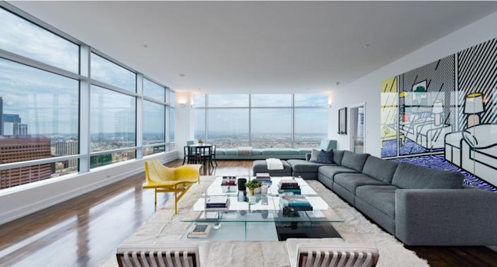 The scenic corner-unit condo holds three bedrooms and four bathrooms in 4,250 square feet.