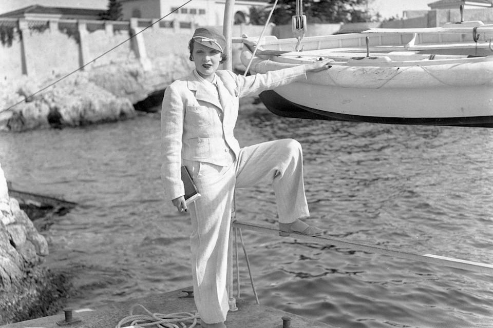 <p>Marlene Dietrich shows off her signature style while posing seaside in France.</p>