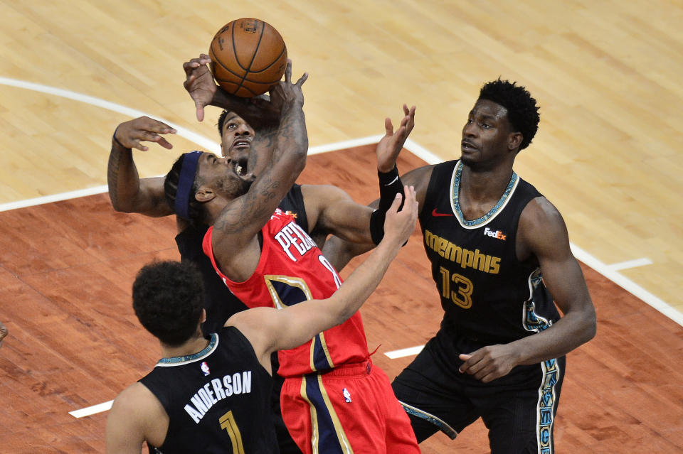 New Orleans Pelicans forward Naji Marshall (8) struggles for control of the ball between Memphis Grizzlies forwards Jaren Jackson Jr., (13), Kyle Anderson (1), and center Xavier Tillman in the second half of an NBA basketball game Monday, May 10, 2021, in Memphis, Tenn. (AP Photo/Brandon Dill)