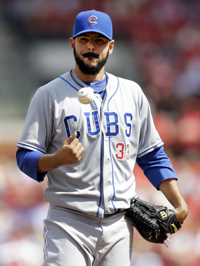 Chicago Cubs starting pitcher Carlos Villanueva tosses a ball in the air as he waits on the mound to be removed from a baseball game against the St. Louis Cardinals during the fourth inning Saturday, April 12, 2014, in St. Louis. The Cardinals won 10-4. (AP Photo/Jeff Roberson)