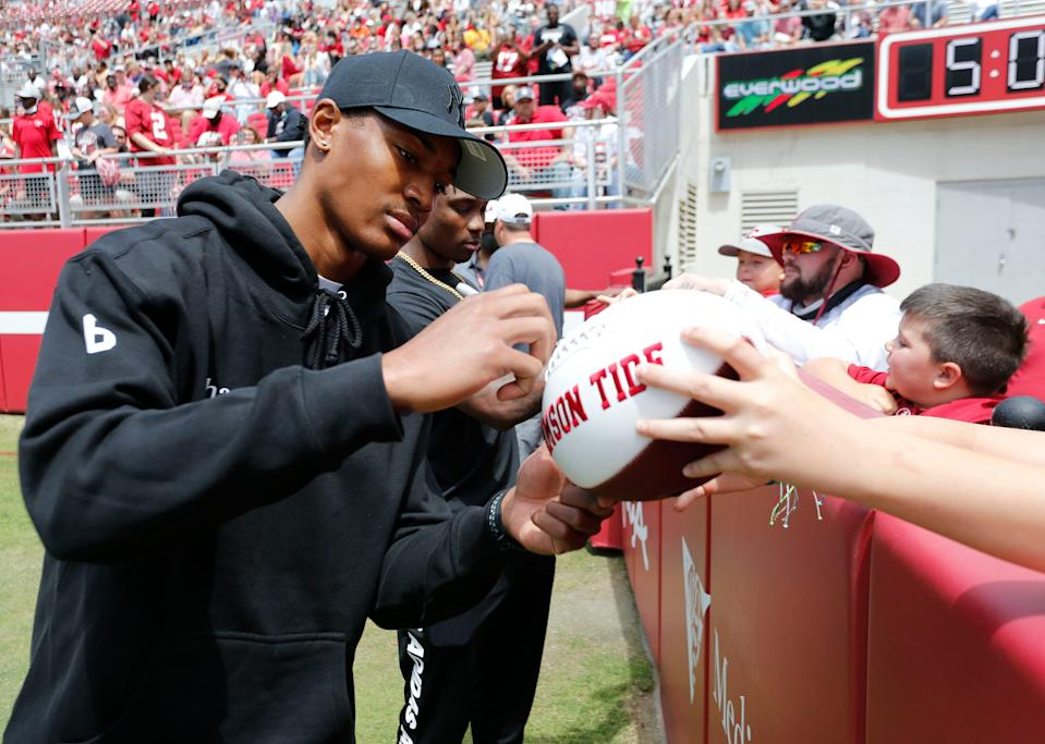 Heisman Trophy winner Devonta Smith signs autographs for fans during the University of Alabama A-Day Game at Bryant-Denny Stadium on Saturday in Tuscaloosa.