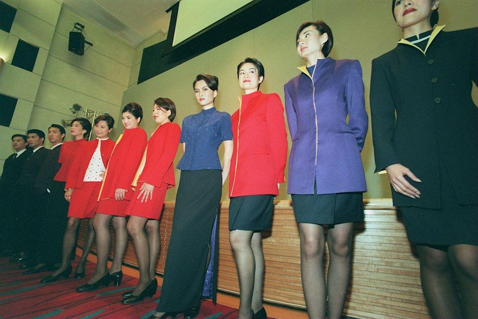 <p>Cathay Pacific flight attendants modeling the airline's new uniforms. </p>