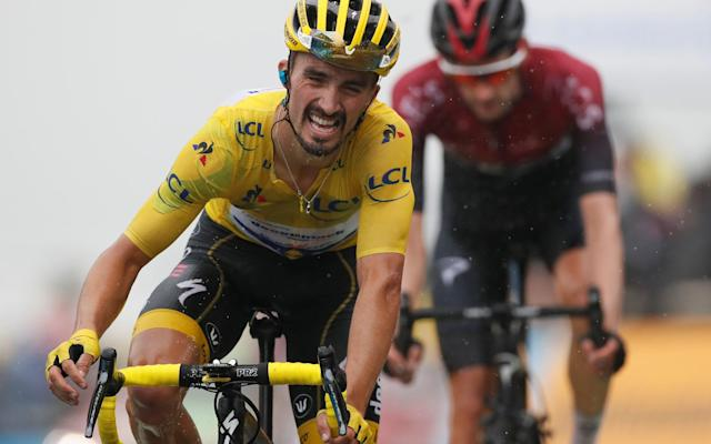 Julian Alaphilippe kept hold of his leader's yellow jersey despite a wobble on the final climb - REUTERS