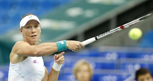 Australia's Samantha Stosur returns a ball to Serbia's Anna Ivanovic during a quarterfinal match at the Kremlin Cup tennis tournament in Moscow, Russia, Friday, Oct. 18, 2013. (AP Photo/Misha Japaridze)