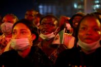 A demonstrator shouts the slogan as he holds the Nigerian flag during protest against alleged police brutality in Lagos