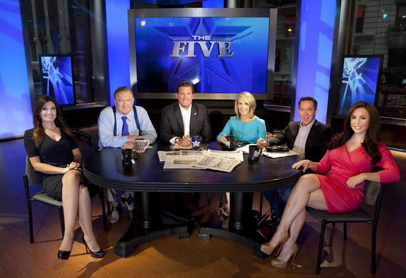"This July 1, 2013 photo shows, from left, Kimberly Guilfoyle, Bob Beckel, Eric Bolling, Dana Perino, Greg Gutfeld and Andrea Tantaros co-hosts of Fox News Channel's ""The Five"" following a taping of the show in New York. The program's deceptively simple premise is five folks sitting around a table at 5 p.m. EDT, kicking around the day's news and hot topics. This year ""The Five"" has emerged as Fox's second most popular show, behind only Bill O'Reilly, despite not having the larger pool of potential viewers that prime time usually provides. (Photo by Carlo Allegri/Invision/AP)"