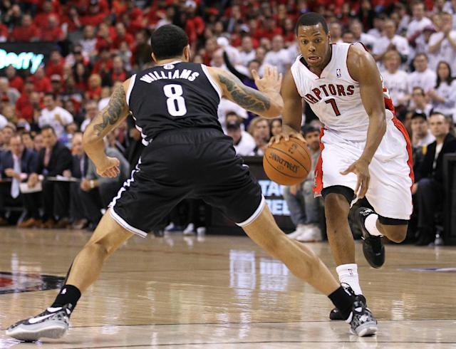 Kyle Lowry (R) of the Toronto Raptors goes up against Deron Williams of the Brooklyn Nets in Game Seven of the NBA Eastern Conference Quarterfinals on May 4, 2014 in Toronto, Ontario, Canada (AFP Photo/Claus Andersen)