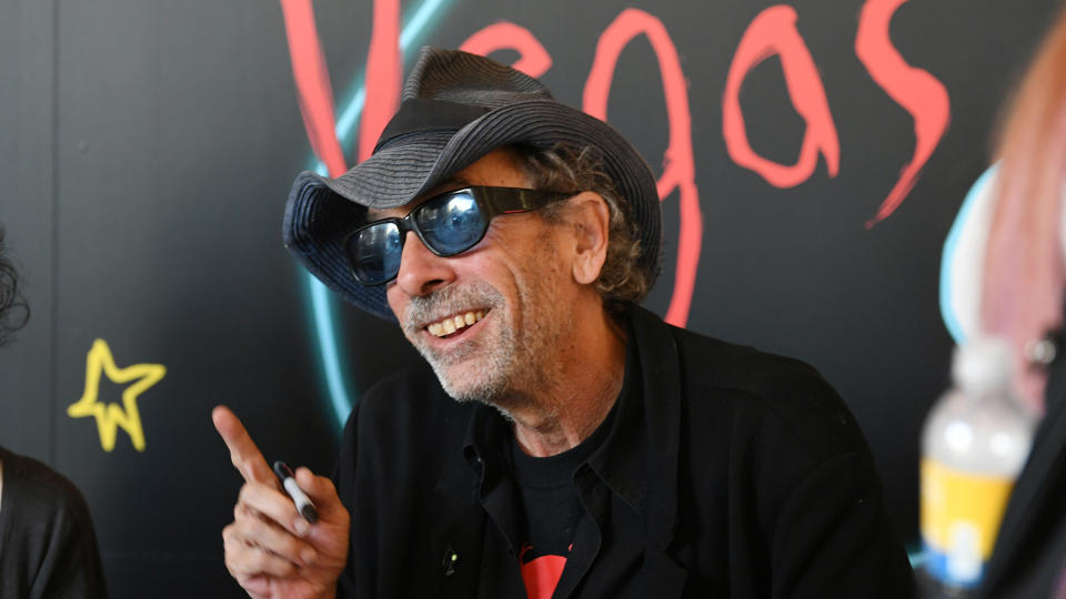 "Tim Burton signs books at his exhibition ""Lost Vegas: Tim Burton @ The Neon Museum"" on October 15, 2019. (Photo by Denise Truscello/WireImage)"