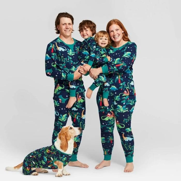 """<p>These <a href=""""https://www.popsugar.com/buy/Target-Holiday-Print-Pajamas-497583?p_name=Target%20Holiday%20Print%20Pajamas&retailer=target.com&pid=497583&price=10&evar1=moms%3Aus&evar9=45363393&evar98=https%3A%2F%2Fwww.popsugar.com%2Fphoto-gallery%2F45363393%2Fimage%2F46750366%2FTarget-Holiday-Dinosaur-Print-Pajamas&list1=target%2Cpajamas%2Choliday&prop13=api&pdata=1"""" rel=""""nofollow"""" data-shoppable-link=""""1"""" target=""""_blank"""" class=""""ga-track"""" data-ga-category=""""Related"""" data-ga-label=""""https://www.target.com/p/kids-holiday-dinosaur-print-pajama-set-wondershop-navy/-/A-76581534?preselect=54655953#lnk=sametab"""" data-ga-action=""""In-Line Links"""">Target Holiday Print Pajamas</a> ($10-$25) are perfect for a family who loves dinosaurs.</p>"""