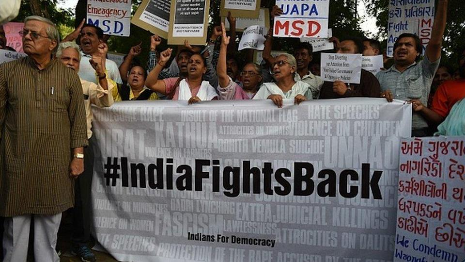 Indian protesters take part in a rally against the recent arrests of lawyers and left-wing activists, in Ahmedabad on September 5, 2018.