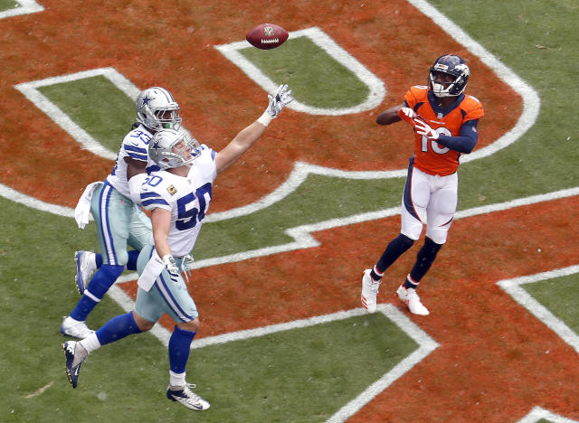 <p>Denver Broncos wide receiver Emmanuel Sanders (10) pulls in a touchdown catch as Dallas Cowboys middle linebacker Sean Lee (50) and cornerback Chidobe Awuzie (33) defend during the first half of an NFL football game, Sunday, Sept. 17, 2017, in Denver. (AP Photo/Joe Mahoney) </p>