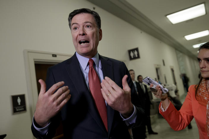 Former FBI Director James Comey speaks to reporters on Capitol Hill Washington, Monday, Dec. 17, 2018, after a second closed-door interview with two Republican-led committees investigating what they say was bias at the Justice Department before the 2016 presidential election. (AP Photo/J. Scott Applewhite)