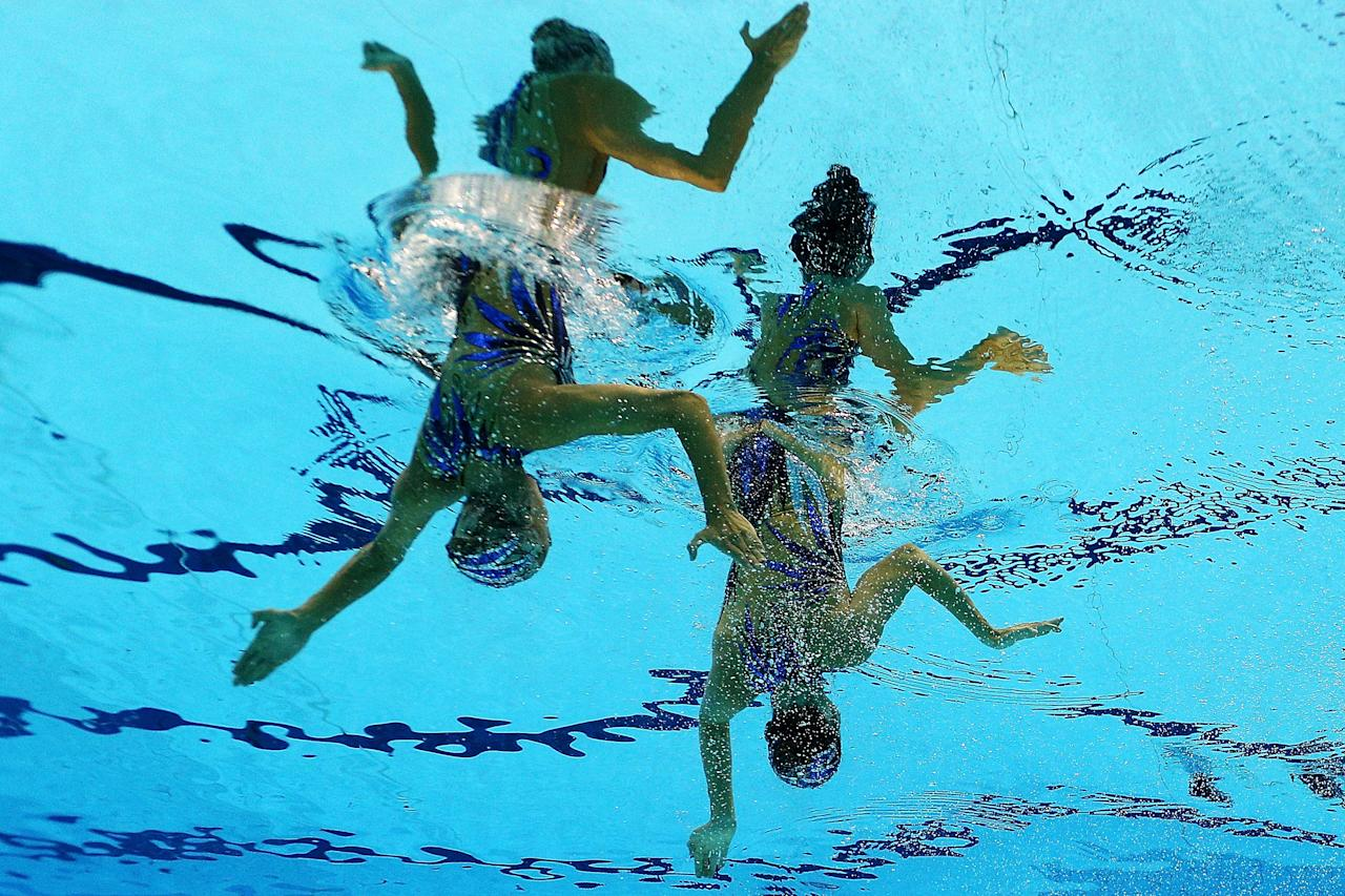 Olivia Federici and Jenna Randall of Great Britain compete in the Women's Duets Synchronised Swimming Free Routine Final on Day 11 of the London 2012 Olympic Games at the Aquatics Centre on August 7, 2012 in London, England.  (Photo by Clive Rose/Getty Images)