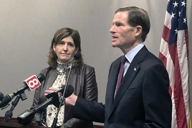 In this Dec. 27, 2019, photo, Karen Jarmoc, left, CEO of the Connecticut Coalition Against Domestic Violence, stands with U.S. Sen. Richard Blumenthal, D-Conn., at a news conference Hartford to announce federal funding to help domestic violence groups provide services to victims. Jarmoc said the case of Jennifer Dulos, the Connecticut mother of five who police believe was killed by her estranged husband, highlights the need to improve how family courts handle cases involving accusations of domestic violence. (AP Photo/Susan Haigh)