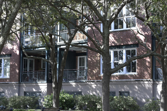 "This photo shows the outside of a Charleston, S.C., condominium belonging to Eugene Zurlo on Monday, Oct. 19, 2020. The Trump administration recently gave the longtime Republican political donor seed money to test a possible COVID-19-fighting blood plasma technology, noting Zurlo's ""manufacturing facilities"" in Charleston. An AP investigation found no manufacturing facilities. The company operates out of Zurlo's condo. He and his partners may now be in line for as much as $65 million in taxpayer money. (AP Photo/Meg Kinnard)"