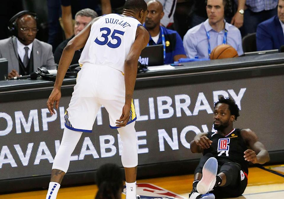 Kevin Durant clashes with Patrick Beverley in Game 1. (Photo by Lachlan Cunningham/Getty Images)