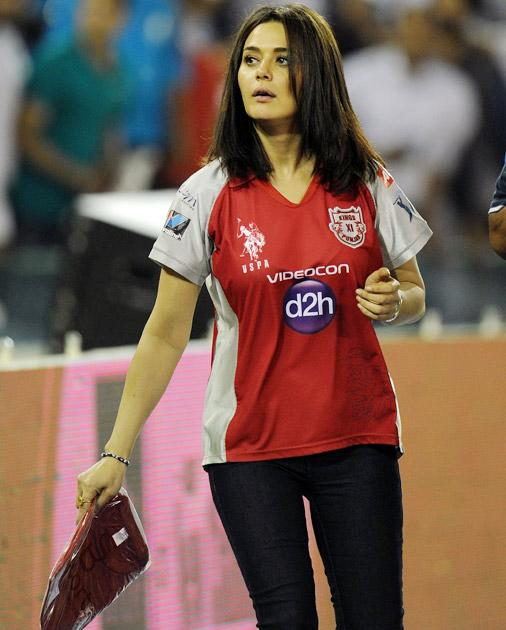 Kings XI Punjab team owner Bollywood actress Preity Zinta distributes t-shirts to spectators during the IPL Twenty20 cricket match between Kings XI Punjab and Pune Warriors at PCA Stadium in Mohali on April 12, 2012. AFP PHOTO/ Prakash SINGH