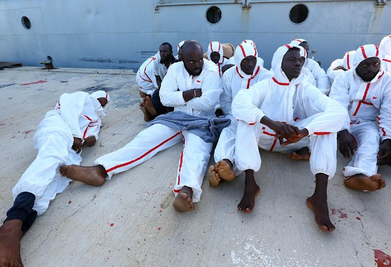 African migrants wait to receive medical treatment at a naval base in Tripoli on November 25, 2017, after more than 30 migrants died and 200 others were rescued when their boats foundered off Libya's western coast (AFP Photo/MAHMUD TURKIA)
