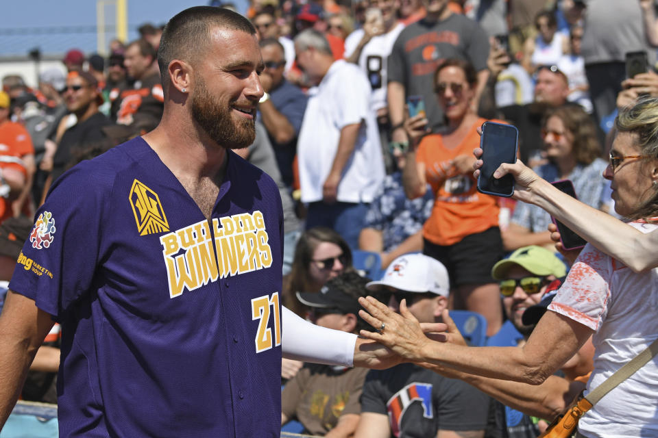 Kansas City Chiefs tight end Travis Kelce smiles for fans before the Jarvis Landry Celebrity Softball game, Saturday, June 12, 2021, in Eastlake, Ohio. (AP Photo/David Dermer)