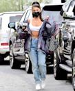 <p>Ariana Grande makes her way to a Los Angeles studio with coffee in hand on Thursday.</p>