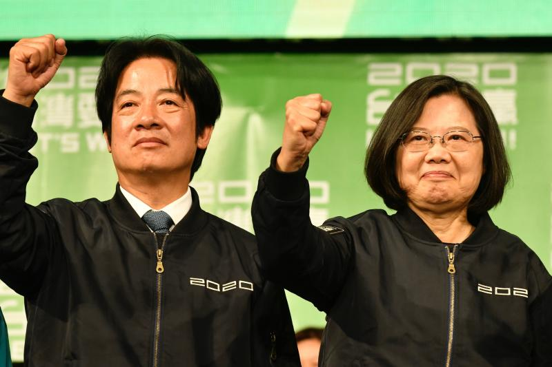 Taiwan President Tsai Ing-wen (R) and Vice President-elect William Lai (L) gesture outside the campaign headquarters in Taipei on January 11, 2020. - President Tsai Ing-wen declared victory in Taiwan's election on January 11 as votes were being counted after an election battle dominated by the democratic island's fraught relationship with China. (Photo by Sam Yeh / AFP) (Photo by SAM YEH/AFP via Getty Images)