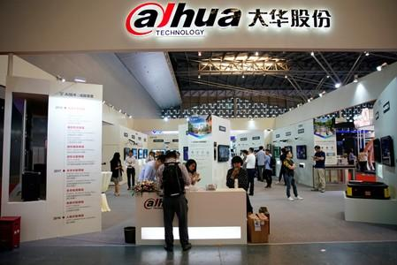 People visit a Dahua Technology booth at a security exhibition in Shangha