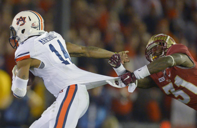 Florida State's Terrence Brooks (31) tries to tackle Auburn's Nick Marshall (14) during the second half of the NCAA BCS National Championship college football game Monday, Jan. 6, 2014, in Pasadena, Calif. (AP Photo/Mark J. Terrill)
