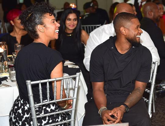 Usher with Grace Miguel at an event in July. (Getty Images)