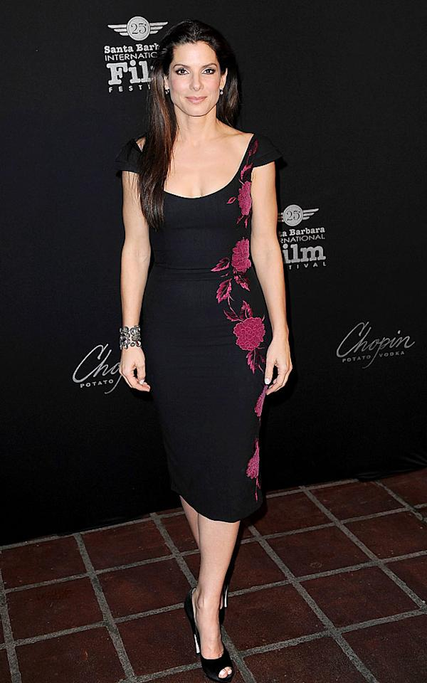 """With only a few weeks left until Sandra Bullock goes for the gold at the 82nd Annual Academy Awards, the """"Blind Side"""" beauty popped by the 2010 Santa Barbara International Film Fest to pick up her latest trophy in an elegantly understated L'Wren Scott frock, bejeweled cuff, and black peep-toes. C Flanigan/<a href=""""http://www.filmmagic.com/"""" target=""""new"""">FilmMagic.com</a> - February 5, 2010"""