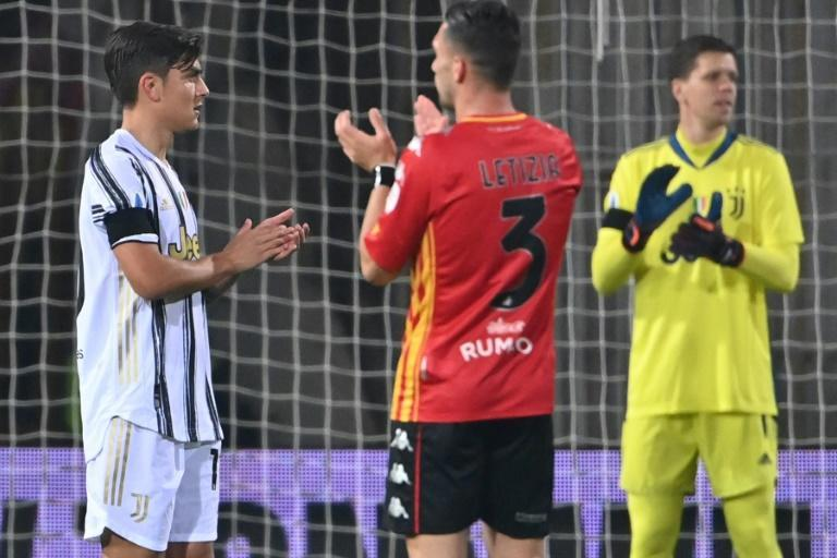 In Benvento, play stopped in the 10th minute as players, including Argentine Juventus striker Paulo Dybala, left, stood and applauded Maradona