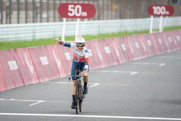Britain's Sarah Storey crosses the finish line to win the women's cycling road individual C5 time trial at the Tokyo 2020 Paralympic Games at the Fuji International Speedway (AFP/CHARLY TRIBALLEAU)