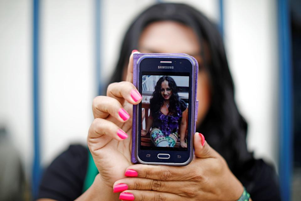 A friend in El Salvador shows a picture of Camila Diaz Cordova, a trans woman killed in that country where she returned after being denied asylum in the U.S. (Photo: Jose Cabezas / Reuters)