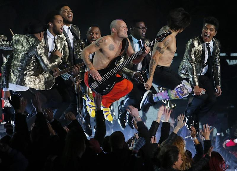 The Red Hot Chili Peppers and Bruno Mars perform during the halftime show of the NFL Super Bowl XLVIII football game between the Seattle Seahawks and the Denver Broncos Sunday, Feb. 2, 2014, in East Rutherford, N.J. (AP Photo/Matt York)