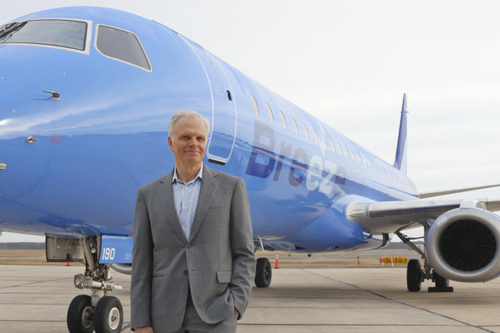 This photo provided by CeanOrrett shows David Neeleman with Breeze aircraft. Two new U.S. airlines are planning on starting service this spring, tapping into the travel recovery that is picking up speed. Breeze Airways is next up, the latest creation of David Neeleman, who founded JetBlue Airways more than 20 years ago. (CeanOrrett via AP)