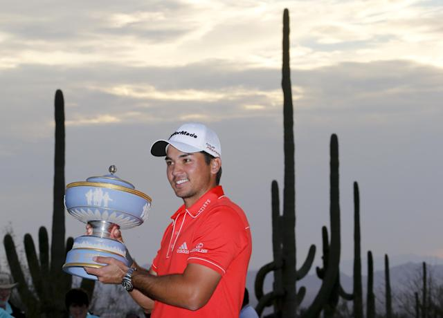 Jason Day, of Australia, poses with the trophy after winning his championship match against Victor Dubuisson, of France, during the Match Play Championship golf tournament, Sunday, Feb. 23, 2014, in Marana, Ariz. (AP Photo/Matt York)