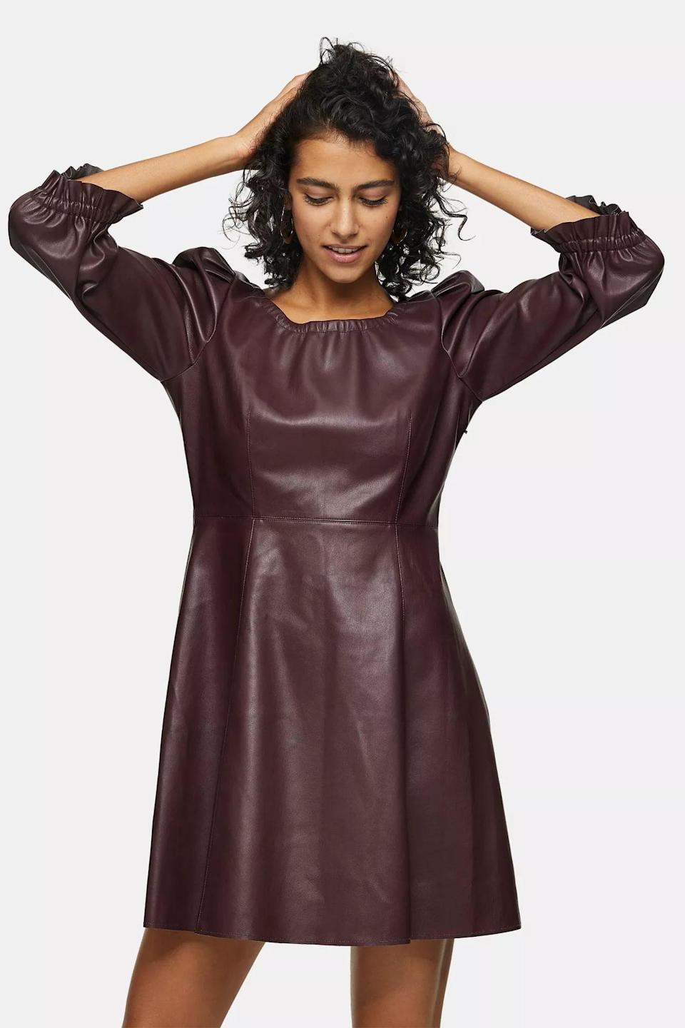 <p>This edgy <span>Burgundy PU Elastic Neck Mini Dress</span> ($95) couldn't be more effortless.</p>