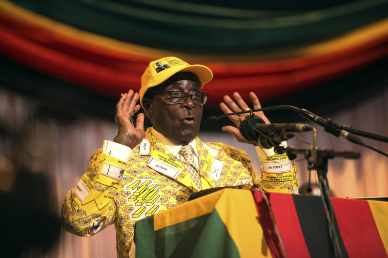 """Zimbabwean President Robert Mugabe delivers his speech at his party's 13th annual conference, in Gweru about 250 Kilometres south west of the capital Harare, Friday, Dec. 7, 2012 .Zimbabwe president's loyalists have converged for an annual party convention in the provincial city of Gweru, hoping to map out a winning election strategy to end a conflict-ridden four-year-old coalition. President Robert Mugabe said in the state media Friday the convention should prepare for a convincing victory """"that will leave no room for doubt."""" The longtime leader has said he wants elections in March, a target that doesn't seem realistic. (AP Photo/Tsvangirayi Mukwazhi)"""