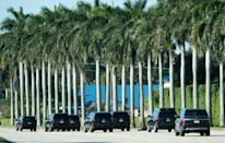 The motorcade of US President Donald Trump arrives at Trump International Golf Club in West Palm Beach, Florida on December 27, 2020