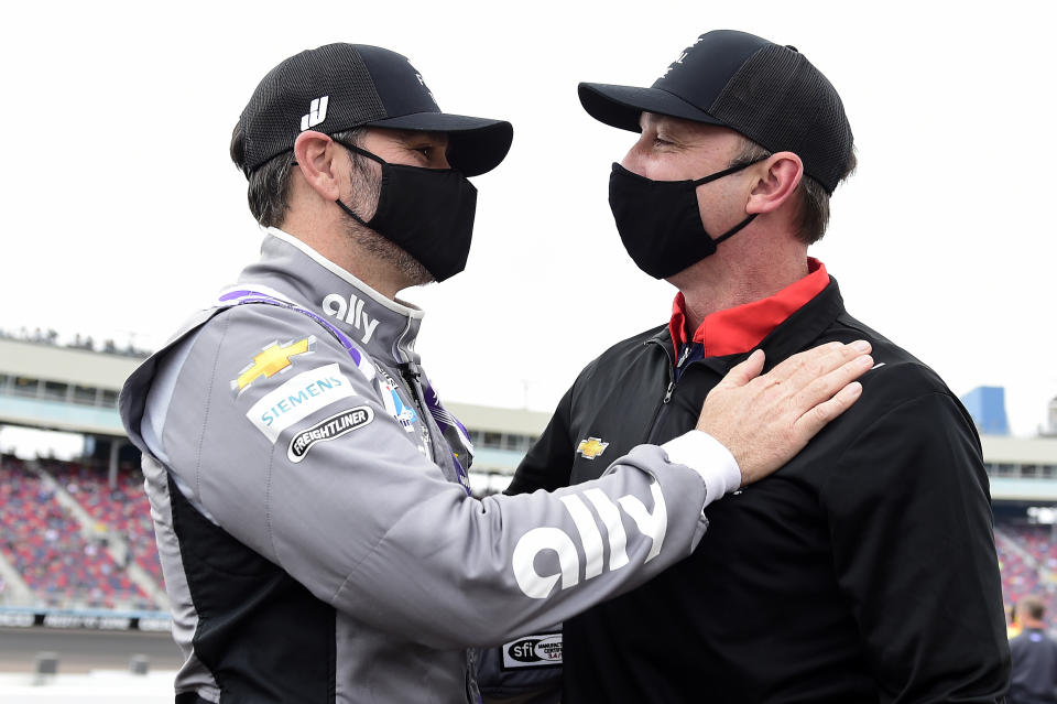 <em>Jimmie Johnson and his former crew chief Chad Knaus share a moment before the NASCAR Cup Series season finale Sunday at Phoenix (Jared C. Tilton/Getty Images).</em>